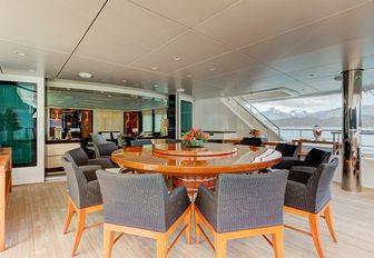 circular alfresco dinning table aboard luxury yacht Party Girl