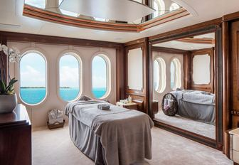 stateroom with large windows transforms into a massage room on board superyacht CALYPSO