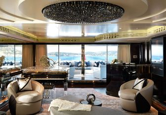 main salon and luxury chandelier on superyacht sealyon