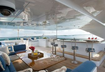 bar and seating area on the sundeck of charter yacht Lady Joy