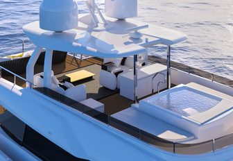 Jacuzzi and seating area on the sundeck of superyacht December Six