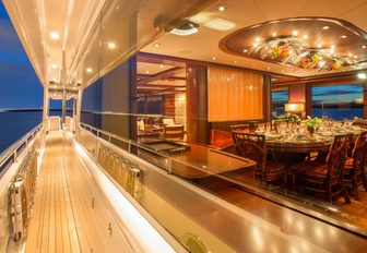 The exterior walkway and formal dining space on board superyacht USHER