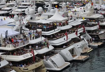 spectators take in the Monaco Grand Prix from superyachts