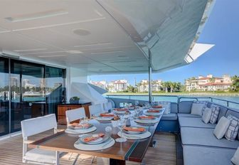 alfresco dining setup on the main deck aft of charter yacht Drew