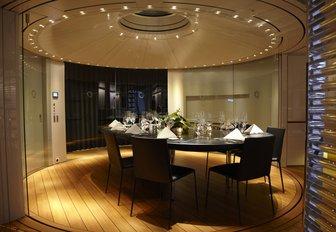 formal interior dining set-up on charter yacht panthalassa