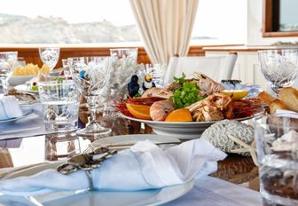 Close up shot of breakfast spread on the dining table of a luxury charter yacht
