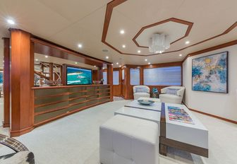 the spacious main salon of charter yacht gota with flat screen tv and sumptuous seating arrangement