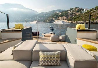 aft deck lounging area with plush sunpads on board luxury yacht ZULU