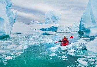 Icebergs in Antarctica man kayaking