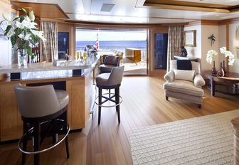 the sophisticated and airy upper lounge of charter yacht lady britt with cocktail bar and lounging space perfect for hosting social gatherings