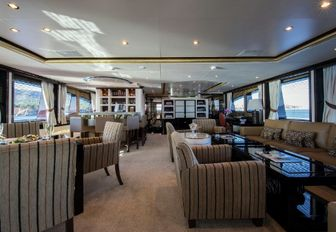 laid-back skylounge with seating area and bar aboard motor yacht DIANE
