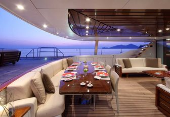 partially shaded alfresco dining and seating on board luxury sailing yacht prana