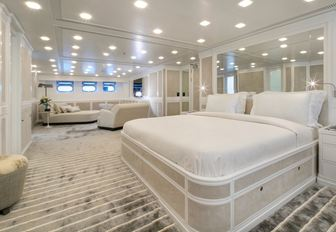 master suite with neutral colour palette and seating area on board luxury yacht Spirit of the C's