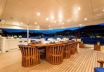 alfresco dining at night on board luxury yacht MISCHIEF