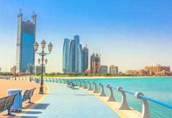 Corniche promenade with Abu Dhabi cityscape in the distance