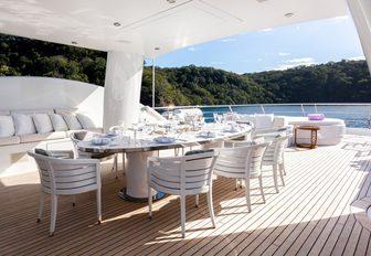 alfresco dining area under the radar arch on board luxury yacht 'Step One'