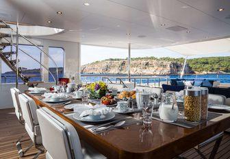 alfresco dining area on board superyacht GO