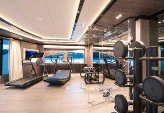 The gymnasium on board superyacht O'PTASIA