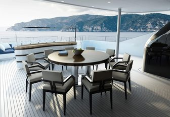 the alfresco dining area and cocktail bar on the upper aft deck of crewed yacht SOARING