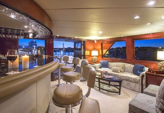 bar and seating in the skylounge of motor yacht Sweet Escape