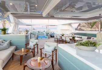 expansive sundeck with bar, seating areas and Jacuzzi on board charter yacht 'King Baby'