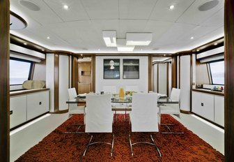 bunker interior dining with white table and chairs