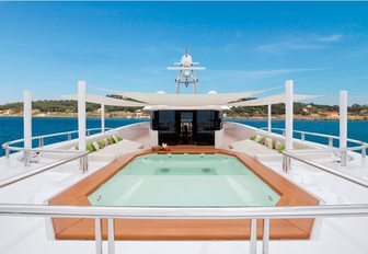 spa pool surrounded by sun pads on the sundeck of charter yacht Mogambo