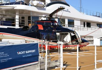helicopter on the helipad of superyacht Power Play at the Monaco Yacht Show 2018