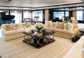 pop art-inspired main salon with sumptuous seating and piano aboard charter yacht 'Alfa Nero'