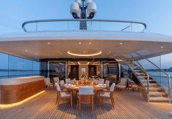 luxury yacht hasna alfresco dining area with shade