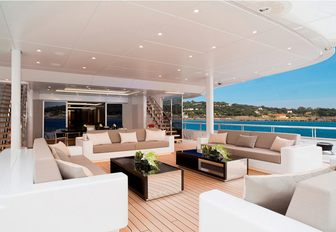 aft deck lounge and dining area on board motor yacht Mogambo