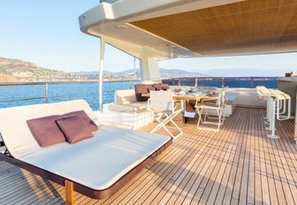 loungers, alfresco dining and bar aboard sundeck of luxury yacht NARVALO