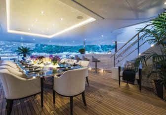 alfresco dining area is setup for dinner on the upper deck aft of charter yacht 11/11