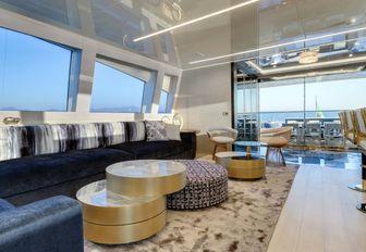 navy blue sofas in the light-filled main salon of superyacht Da Vinci