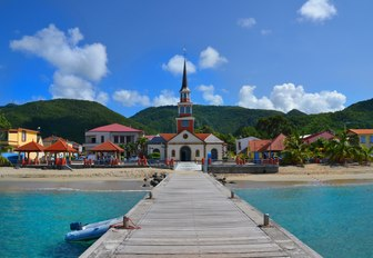 a quiet and colourful coastal settlement in the Caribbean as part of luxury yacht charter itinerary