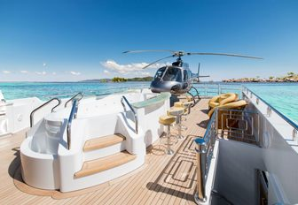 sundeck of my seanna with spa pool and helicopter in background