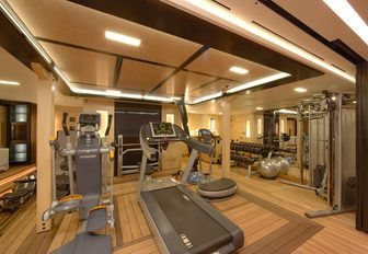 A treadmill and cross trainer in the gymnasium of superyacht AMARYLLIS