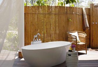 outdoor bath adjoining suites on thanda island