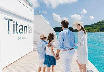 family arrive on the swim platform of motor yacht TITANIA