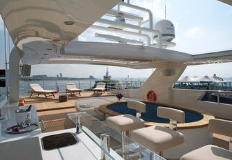 bar and dip pool with sun loungers beyond on the sundeck of luxury yacht TATIANA