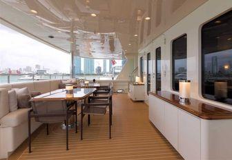 rectangular alfresco dining option on aft deck of luxury yacht SAFIRA
