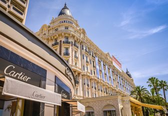 Cartier boutique with the luxury Inter Continental Carlton hotel in the background along La Croisette in Cannes