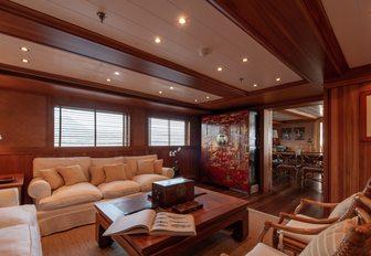 Comfortable living area on superyacht Bleu De Nimes with sofa and table