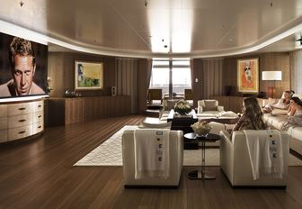 charter guests watch a movie on the wide-screen TV on board motor yacht Lady E