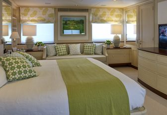 master suite with pale green and cream colour palette on board superyacht ANCALLIA