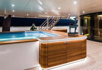 recessed swimming pool on the main deck aft of luxury yacht 'Here Comes The Sun'
