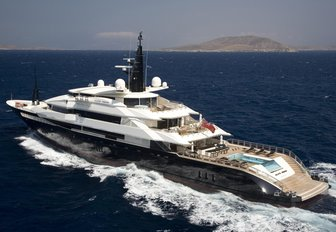 charter yacht Alfa Nero underway on a charter vacation with a view of her aft deck swimming pool