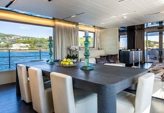 Dining table and chairs inside on motor yacht Cinquanta 50