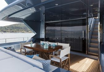 Covered outdoor dining area on superyacht 55 FIFTYFIVE