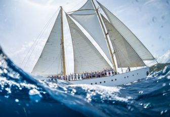 charter yacht CHRONOS cuts through the water during the Antigua Classic Yacht Regatta